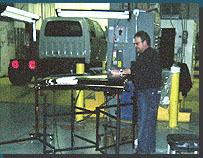 Instructor John Rademacher helping a student perform PDR on a tailgate